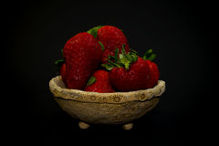 Strawberry in pot. Strawberry in unglased handmade pot Stock Image