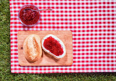 Strawberry preserve with a fresh crusty roll Stock Photography