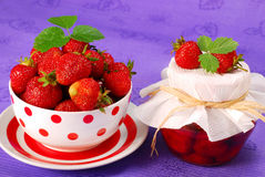 Strawberry  preserves and bowl of fresh fruits Royalty Free Stock Photos