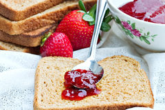 Strawberry preserves and whole wheat t Stock Image