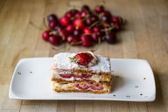 Strawberry puff mille-feuille with cherry Royalty Free Stock Photography