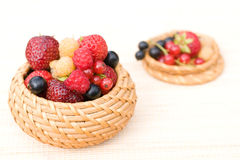 Strawberry, raspberry, black currant, red currant. In a bast basket Stock Photo
