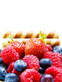 Strawberry, raspberry and blueberry on white. Fruits Delight - raspberry, strawberry, blueberry and waffles isolated on white background Royalty Free Stock Photo