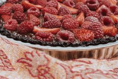 Strawberry raspberry chocolate tart delicious stock photography