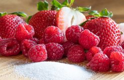 Strawberry. Raspberry. Fruits. Raw. Sugar. Macro. Red royalty free stock photo