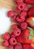 Strawberry. Raspberry Fruits. Sugar. Macro. Raw. Red royalty free stock images
