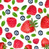 Strawberry and Raspberry Pattern. Various fresh berries isolated. On white background, close up. Flying Strawberry, Mint, Raspberry and Blueberry Royalty Free Stock Photography