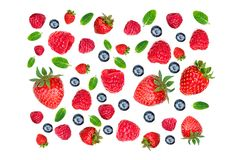 Strawberry and Raspberry Pattern. Various fresh berries isolated. On white background, close up. Flying Strawberry, Mint, Raspberry and Blueberry Stock Photography