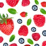 Strawberry and Raspberry Pattern. Various fresh berries isolated. On white background, close up. Flying Strawberry, Mint, Raspberry and Blueberry Stock Image