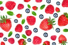 Strawberry and Raspberry Pattern. Various fresh berries isolated. On white background, close up. Flying Strawberry, Mint, Raspberry and Blueberry Royalty Free Stock Images