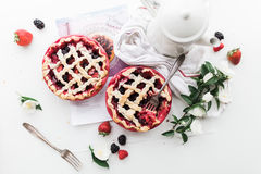 Strawberry and Raspberry Pie Near White Ceramic Pitcher Stock Photo