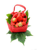 Strawberry. In a red basket on a white background Royalty Free Stock Photos