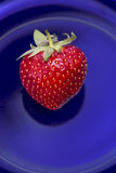 Strawberry. Red strawberry on a blue glass background Royalty Free Stock Photos