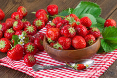 Strawberry on red checkered tablecloth Royalty Free Stock Photo