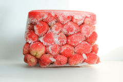 Strawberry red frozen in a container to keep Stock Image