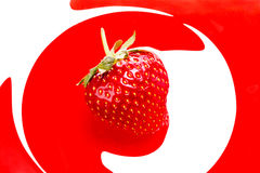 Strawberry. Red strawberry on a white and red  background Royalty Free Stock Photo
