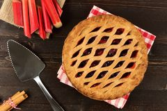 Strawberry and rhubarb pie on dark wood background Royalty Free Stock Image