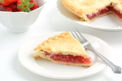 Strawberry rhubarb pie. Fresh baked strawberry rhubarb pie with shallow depth of field Stock Photography