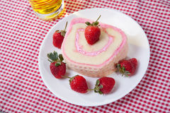 Strawberry Roll Cake with drink. In plate Stock Image