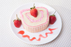 Strawberry Roll Cake with drink. In plate Royalty Free Stock Photo