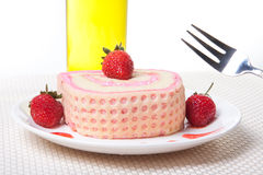 Strawberry Roll Cake with drink. In plate Royalty Free Stock Image
