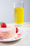 Strawberry Roll Cake with drink. In plate Royalty Free Stock Photography