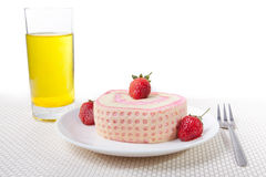 Strawberry Roll Cake with drink. In plate and fork Stock Photography