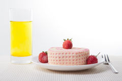 Strawberry Roll Cake with drink. In plate and fork Stock Photos