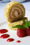 Strawberry Roulade. In sunlight with raspberries Stock Photos