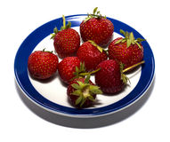Strawberry on a round plate with a blue border Stock Image