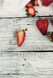 Strawberry on rustic background Stock Images