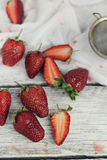 Strawberry on rustic background Royalty Free Stock Photos