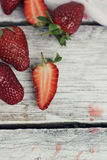 Strawberry on rustic background Royalty Free Stock Photography