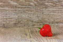Strawberry on a rustic wood background Stock Photography