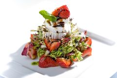 Strawberry salad. With fresh goat cheese and mint, on white Royalty Free Stock Images
