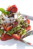 Strawberry salad. With fresh goat cheese and mint, on white, closeup Stock Photo