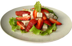 Strawberry salad. Fruit salad with fresh strawberries, tofu and lettuce Royalty Free Stock Image