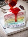 Strawberry sauce on rainbow crape cake Royalty Free Stock Photos