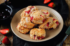 Strawberry scones. On a wood background. toning. selective focus Royalty Free Stock Photos