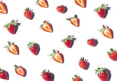 Strawberry seamless pattern on the noon light. Top view fresh berries on the white background royalty free stock photo