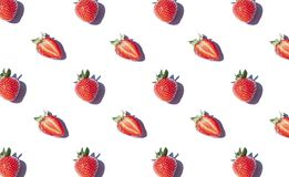 Strawberry seamless pattern on the noon light. Top view fresh berries. On the white background stock photography