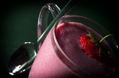 Strawberry shake for healthy life. A cup of strawberry shake with honey Stock Photography