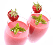 Strawberry shakes. In champagne glasses decorated with a strawberry and mint Royalty Free Stock Photos