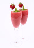 Strawberry shakes. Strawberry shake in champagne glasses decorated with a strawberry and mint Stock Photo