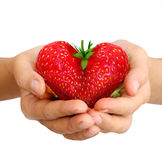 Strawberry in shape of a heart Stock Image