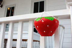 Strawberry Shaped Baked Clay Tree Pot Hanging With Terrace Fence Stock Photo