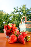 Strawberry and shopping bag on the table Royalty Free Stock Photos