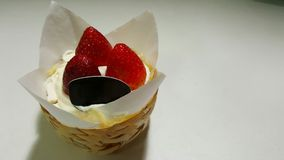 Strawberry shortcake in basket Stock Photos