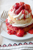 Strawberry shortcake on a napkin with red trim Royalty Free Stock Image
