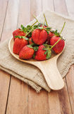 Strawberry shrivel in wooden bowl Stock Photography